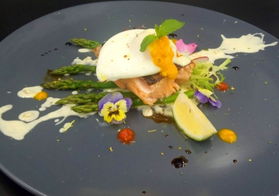 Grilled salmon filled with grilled asparagus and poached eggs